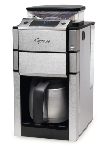 Front right facing view of silver coffee machine featuring a bean to cup grinder and stainless steel thermal carafe. Display features digital clock and options for ground coffee, oily beans, and adjustable cup button.